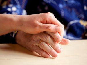 Young hands comforts an elder | Estate Planning and keeping family Insured