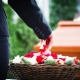 Woman on Funeral putting Roses| Estate Plan matters